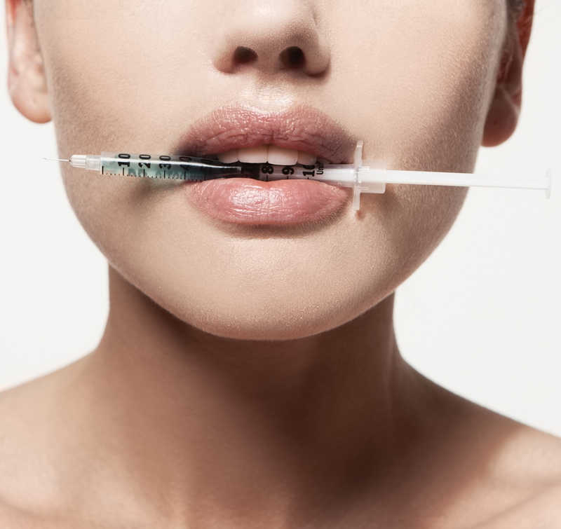closeup of lower half of womans face, syringe in lips | Considering Botox? 4 Reasons You Should Try It! | Masterpiece Skin Restoration
