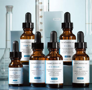 SkinCeuticals serums on blue background