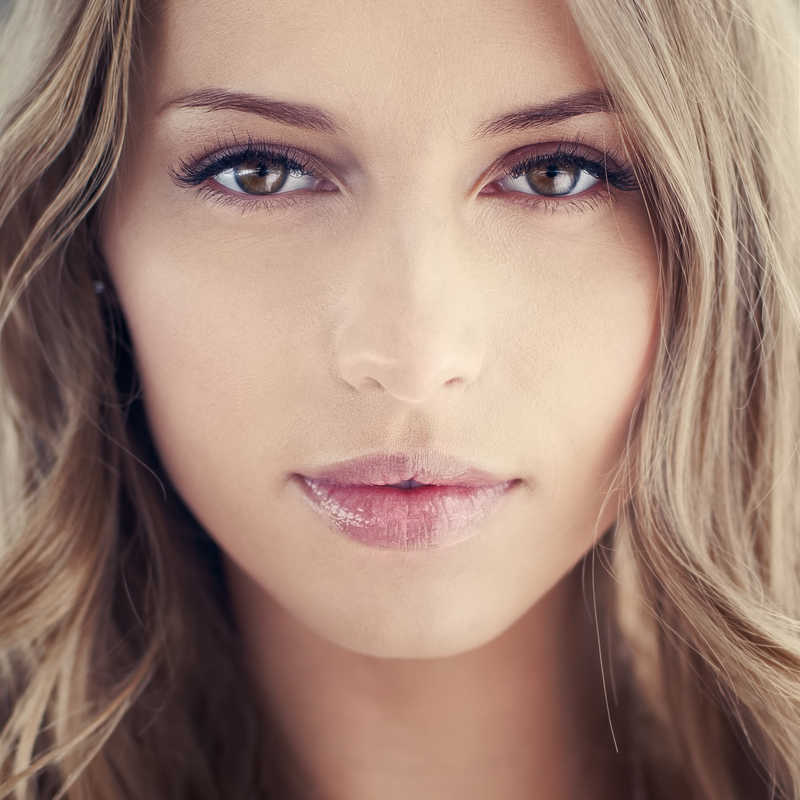 closeup of beautiful young woman with brown eyes | Want Younger-Looking Skin? 3 Ways Retinoids Make Skin Beautiful | Masterpiece Skin Restoration