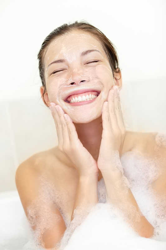 pretty girl washing her face, covered in bubbles | 17 of the Best Ways to Treat Adult Acne! | Masterpiece Skin Restoration