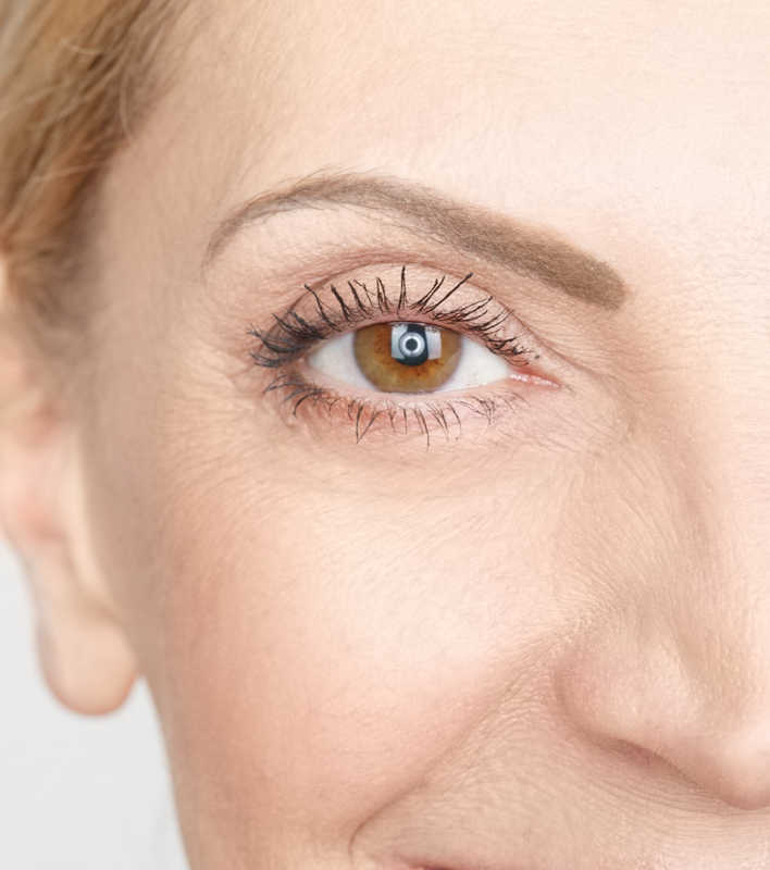 Closeup of a mature woman's brown eye with thinning brow | Got Thinning Lashes & Brows? Lash Extensions & Latisse Can Give You Statement Eyes! | Masterpiece Skin Restoration