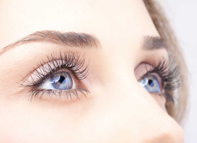 closeup of woman's pretty lashes and blue eyes | Got Thinning Lashes & Brows? Lash Extensions & Latisse Can Give You Statement Eyes! | Masterpiece Skin Restoration