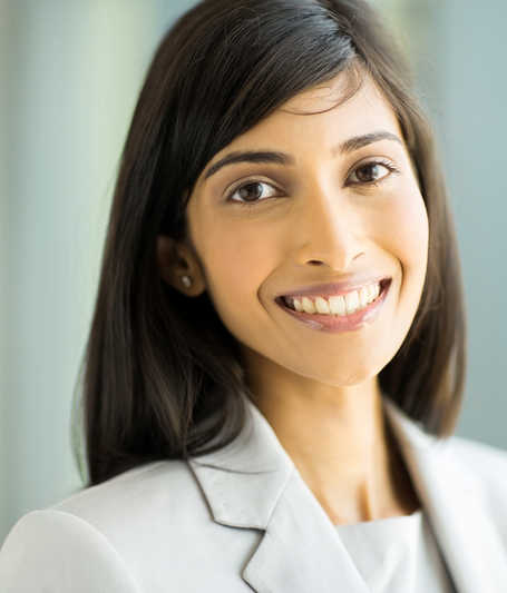 vertical image of beautiful young woman of Indian descent wearing a suit