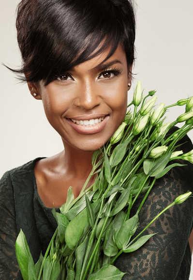 Beautiful woman with dark skin holding a gunch of white flowers   How Platelet Rich Plasma Restores Skin, Scars & Hair   Masterpiece Skin Restoration
