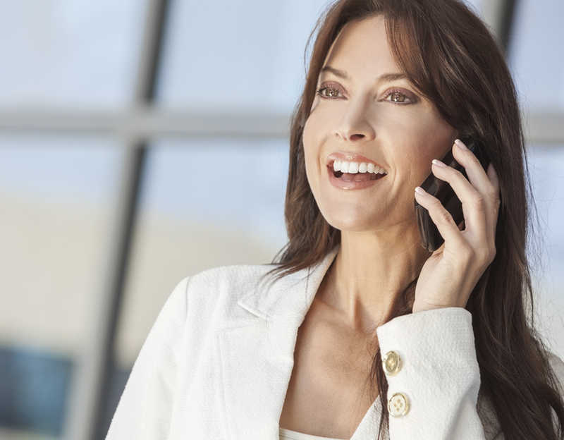 beautiful mature woman, long dark hair, talking on cell phone | 5 Amazing Advantages of Cosmeceutical Skincare Products! | Masterpiece Skin Restoration