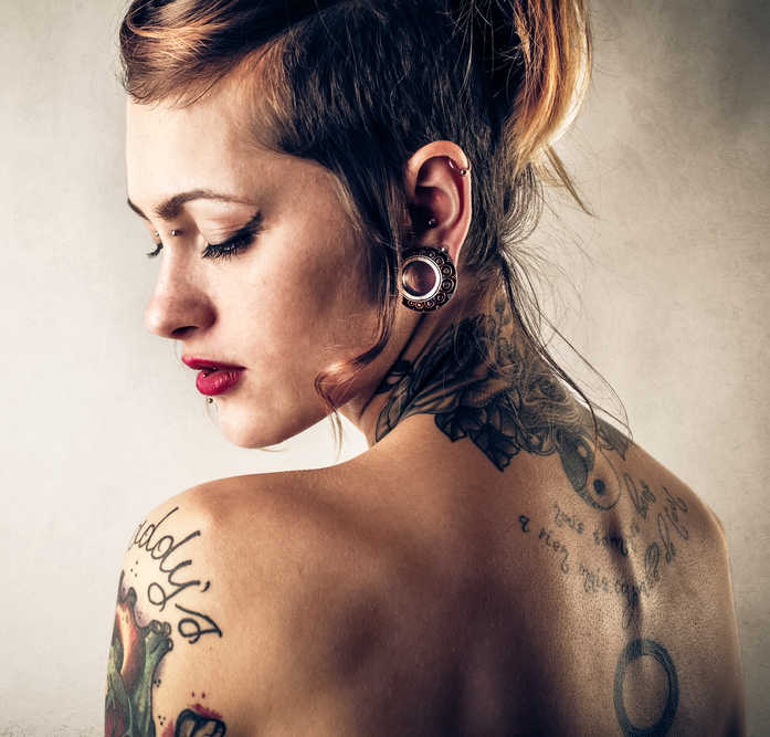 beautiful girl with earlobe gauge and tattoos | 2 Ways to Fix Stretched Earlobes | Masterpiece Skin Restoration