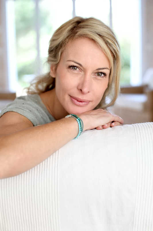 mature woman, pretty skin and eyes, leaning on the back of a couch | Eye Rejuvenation | 21 Methods That REALLY Work! | Masterpiece Skin Restoration