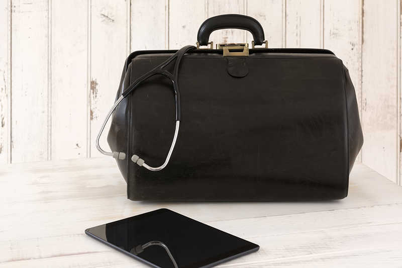 black doctor's bag and tablet