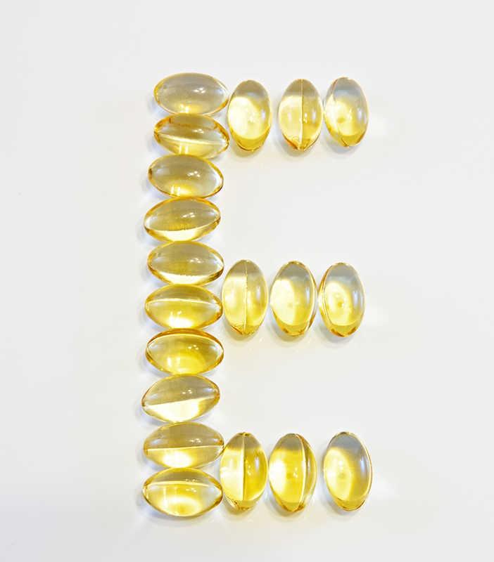 Upper case E written in vitamin E pills | 8 Ingredients in Lip Balm & Cosmetics That Cause Allergies | Masterpiece Skin Restoration