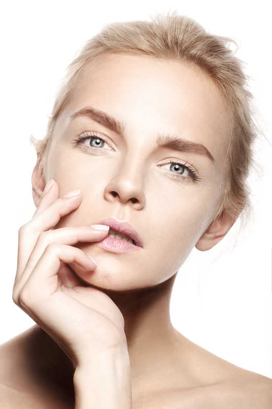 Beautiful young blonde woman with fingers on her pretty lips   20 Ways to Care for Chapped Lips   Masterpiece Skin Restoration