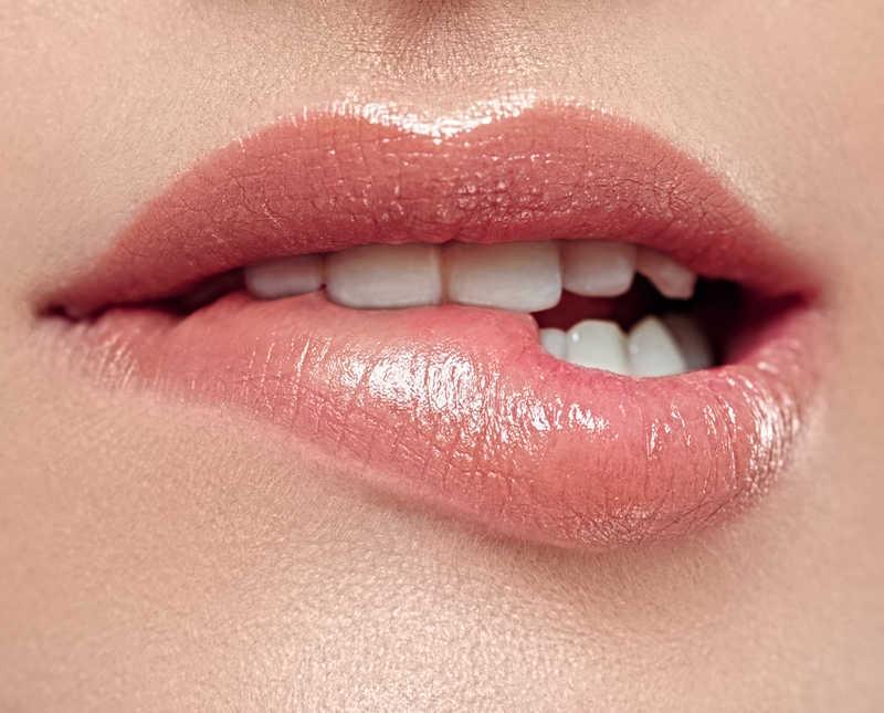 beautiful lips biting bottom lip   20 Ways to Care for Chapped Lips   Masterpiece Skin Restoration