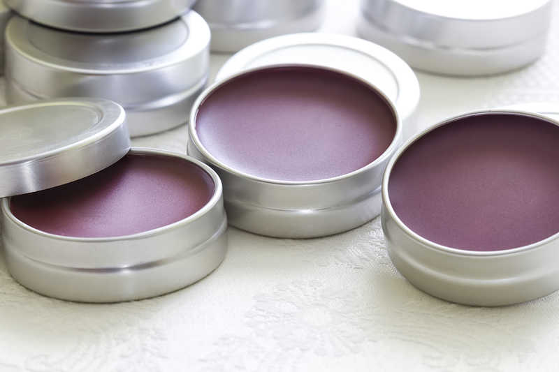 containers of purple lip balm   20 Ways to Care for Chapped Lips   Masterpiece Skin Restoration