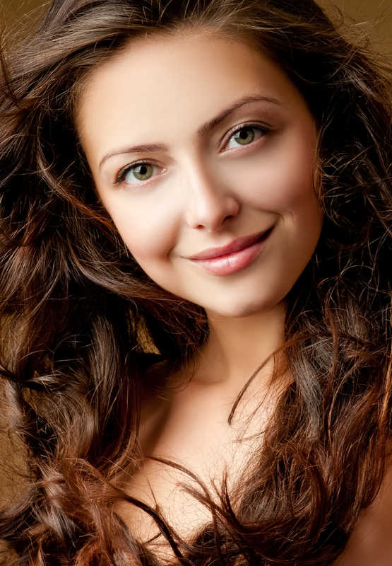 Pretty girl with long wavy hair smiling, beauty tips | 13 Low Cost (& No Cost!) Beauty Tips for Skin | Masterpiece Skin Restoration