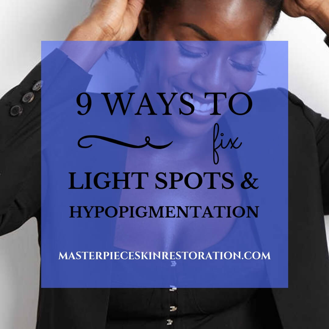 Beautiful dark skinned woman wearing black, hands in hair | 9 Ways to Fix Light Spots & Hypopigmentation | Masterpiece Skin Restoration