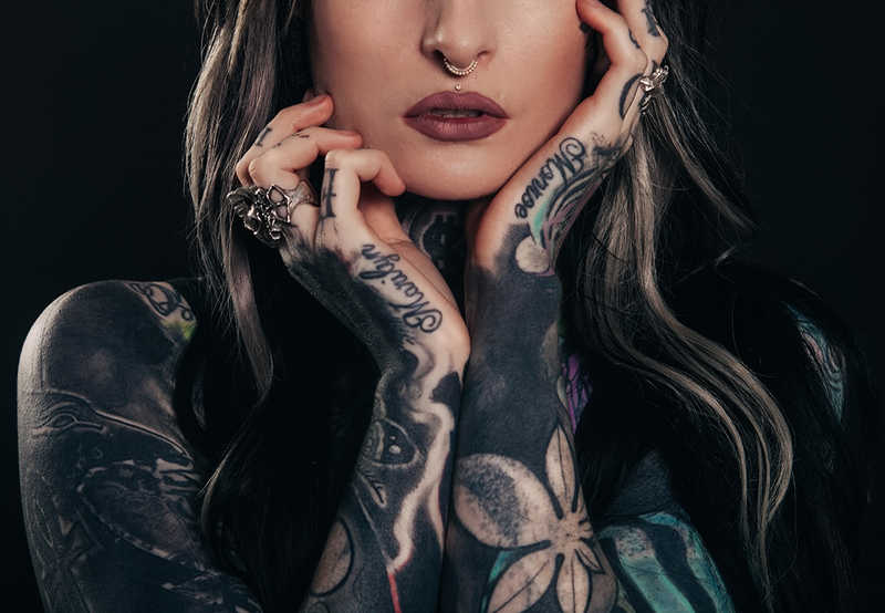 Closeup of lower half of woman's face and tattooed arms   A Tattoo Removal Patch That Works in 6 AMAZING Ways!   Masterpiece Skin Restoration