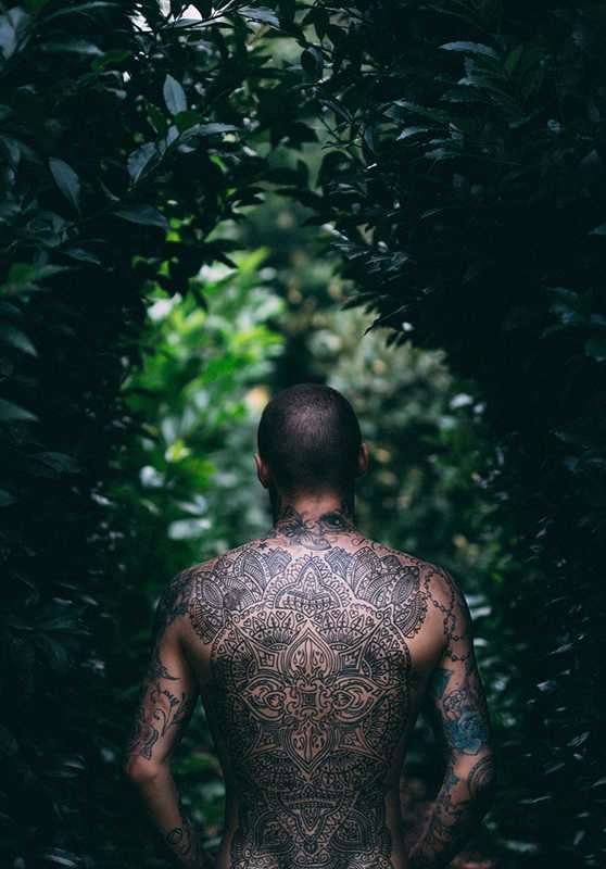 Heavily tattooed man's back   A Tattoo Removal Patch That Works in 6 AMAZING Ways!   Masterpiece Skin Restoration