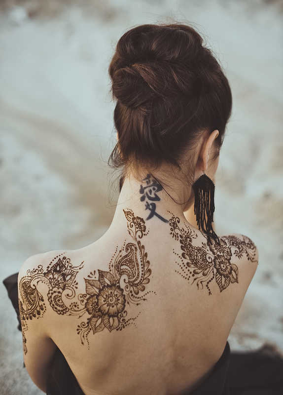 Beautiful woman with a black tattoo on her neck | Tattoo Safety | 13 Ways to Stay Healthy When You Get a Tattoo | Masterpiece Skin Restoration