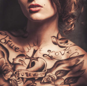 Beautiful woman's chest with black tattoos | Tattoo Safety | 13 Ways to Stay Healthy When You Get a Tattoo | Masterpiece Skin Restoration