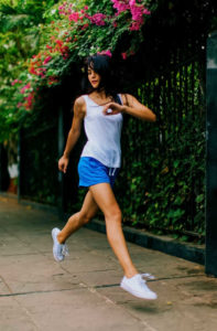 Pretty girl running on a sidewalk | 3 Healthy Resolutions for the New Year That Just Keep Giving! | Masterpiece Skin Restoration