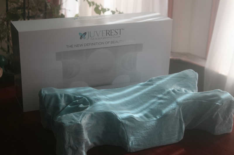 Juverest box and pillow with blue cover sitting on a table | How the Juverest Pillow Helps You Avoid Sleep Wrinkles | Masterpiece Skin Restoration