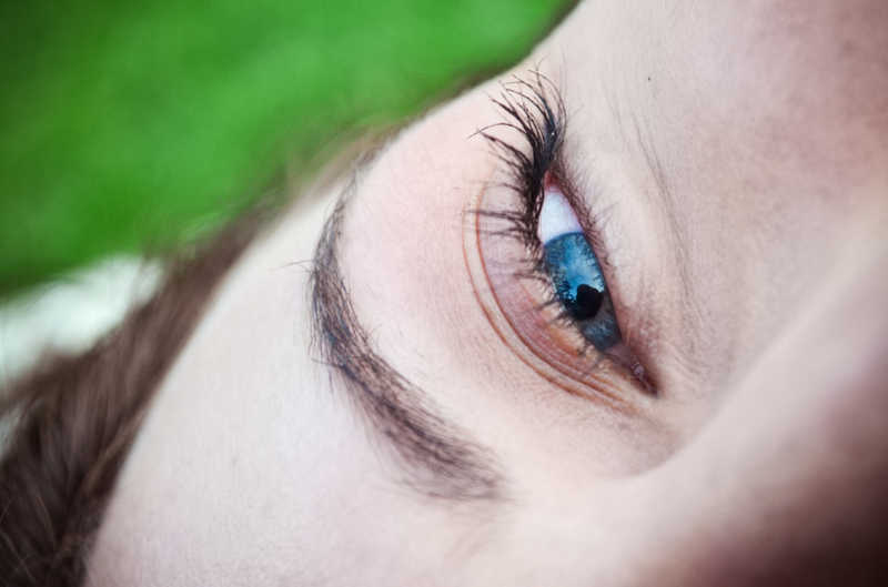 beautiful blue eye, great lashes, lying in grass | The Keratin Lash Lift vs. a Lash Perm | Which Is Better? | Masterpiece Skin Restoration