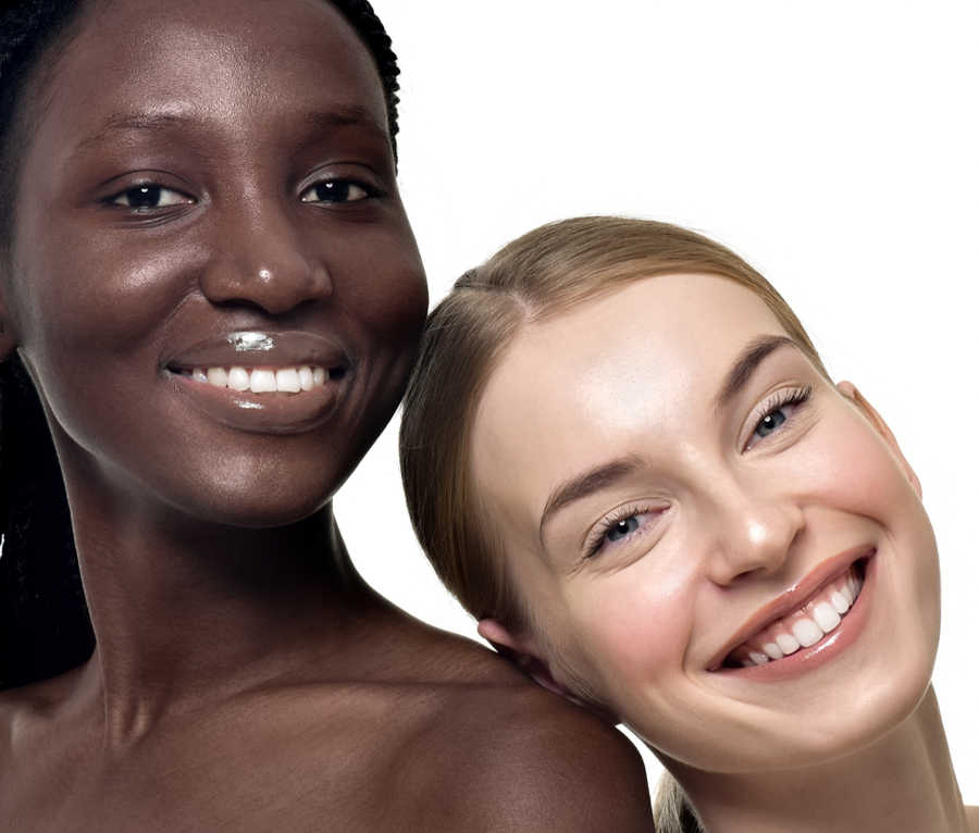 2 pretty women, dark skin & light smiling | Home | Masterpiece Skin Restoration