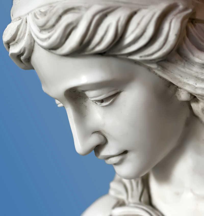 Masterpiece Skin Restoration Logo | closeup of a beautiful statue of a woman against a blue background | Contact Masterepiece Skin Restoration