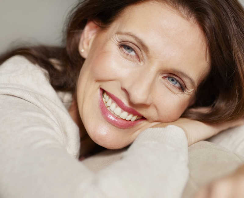 closeup of beautiful mature woman smiling, head on arms | Wrinkles | 6 Great Ways to Treat Them! | Masterpiece Skin Restoration