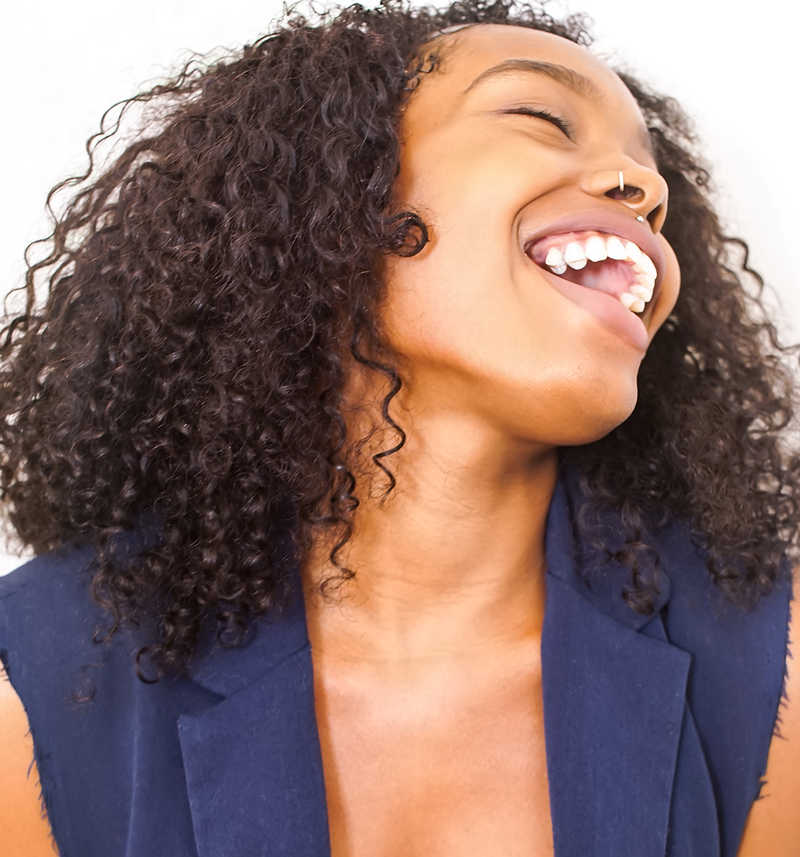 laughing woman with dark skin, unsplash isaiah mcclean web | 9 of the Best Treatments for Dark Skin | Masterpiece Skin Restoration