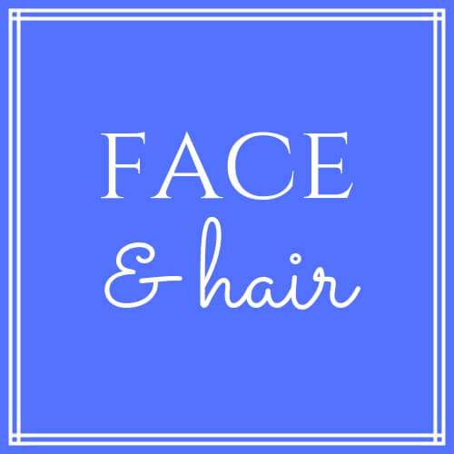"""Face & Hair"" on blue background"