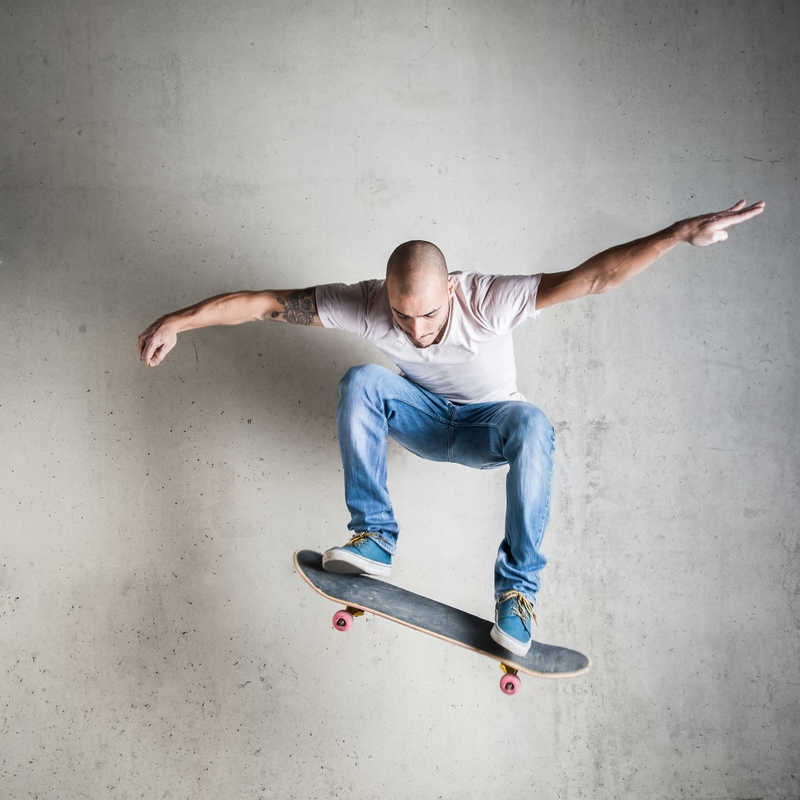 Skateboarder with tattoos | Laser Tattoo Removal | What You Need to Know | Masterpiece Skin Restoration
