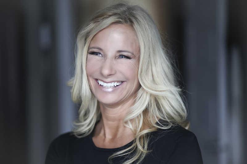 Beautiful blonde mature woman smiling black shirt   Read Our Reviews!   Masterpiece Skin Restoration