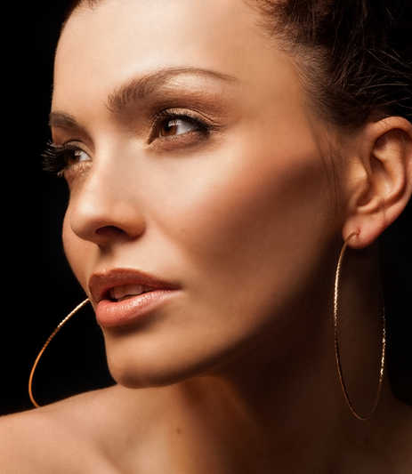 Closeup of a beautiful woman with great cheekbones wearing hoop earrings