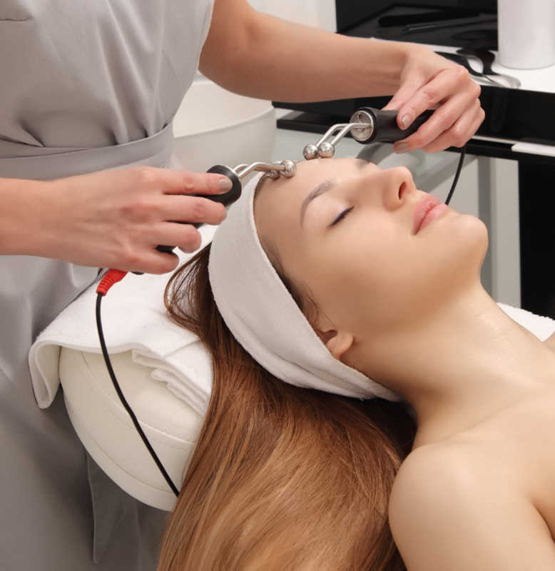 Young woman getting a microcurrent facial | Masterpiece Skin Restoration