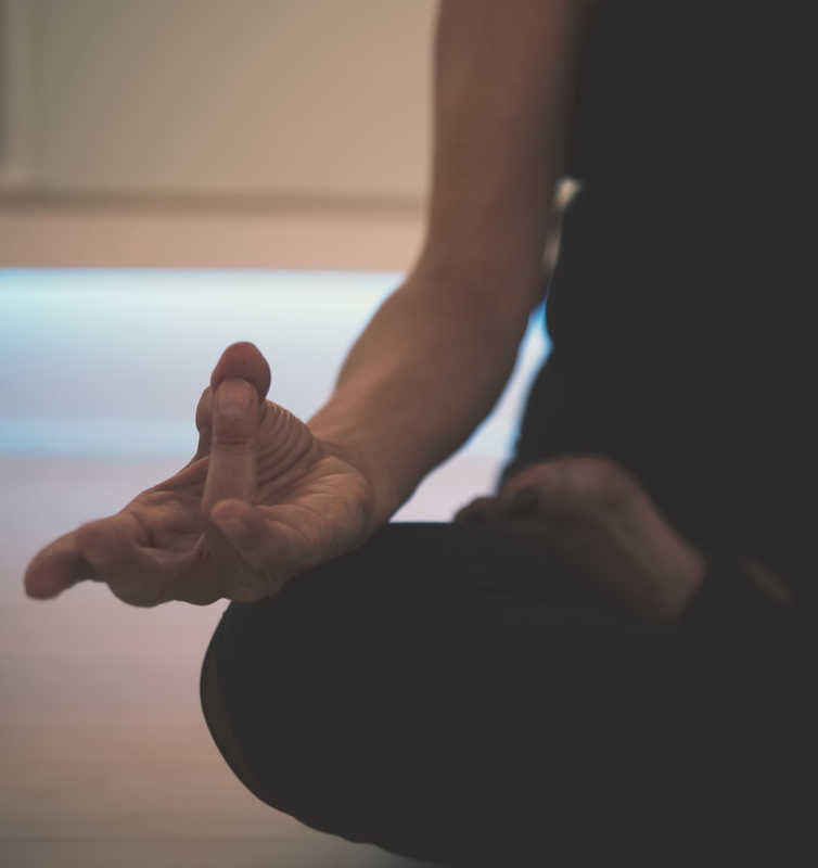 Person sitting and practicing meditation | 11 Science-Based Health Benefits Of Meditation You Didn't Know About | Masterpiece Skin Restoration