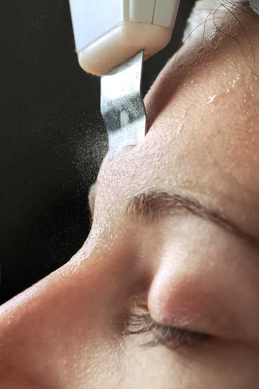 Closeup of Woman getting an ultrasonic facial with an ultrasonic spatula