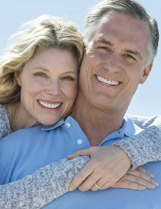 mature couple wearing blue, smiling