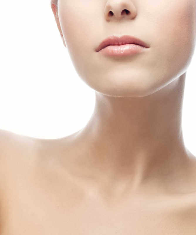 closeup of a woman's neck and chin, pink lips